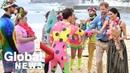 Prince Harry and Meghan attend 'Fluro Friday' session on Australia's Bondi Beach