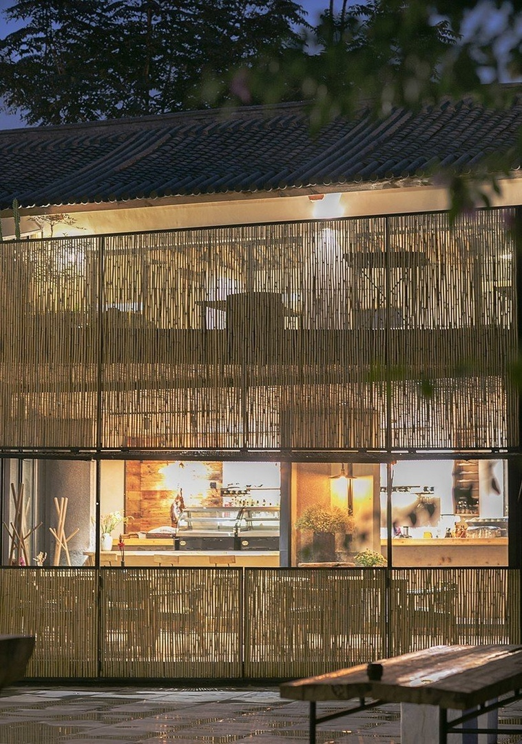 zhaoyang architects has transformed an abandoned office complex into a farm-to-table restaurant and gallery in southwestern china.