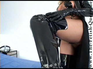 Lady Heike in black lack boots & coat