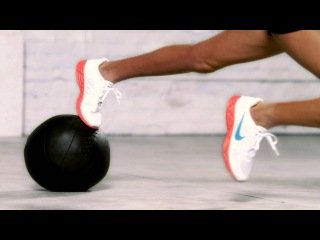 Nike Training Club-Plank with Medicine Ball Knee Tuck