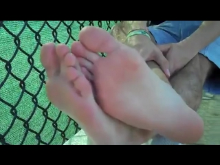 Brendan's long baseball socks and bare feet