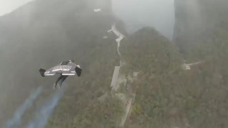 Daredevils Fly Through World s Highest Natural Cave on Jet Powered Wings