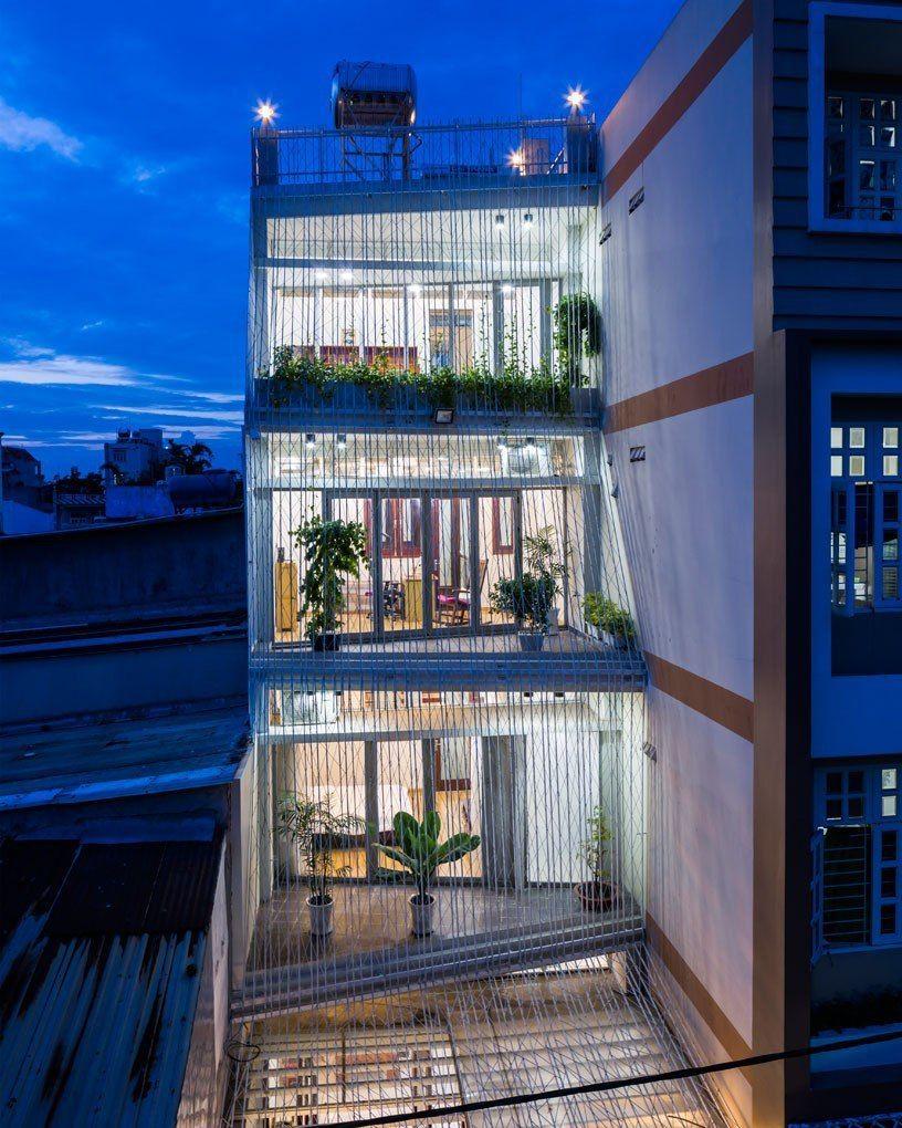 mel schenck envelops breeze house's façade with lattice screens in vietnam