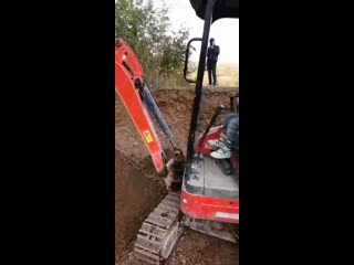 A chinese boy operating a mini excavator like a pro