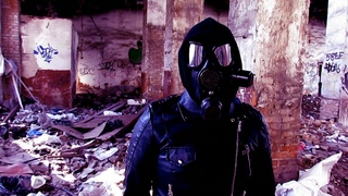 The girl of future on the ruins of the civilization of the past. Girl in gas mask and leather suit